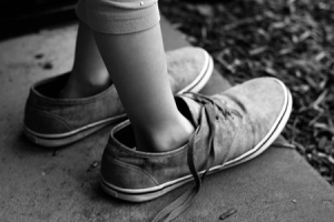 child wearing shoes that are a few sizes too big