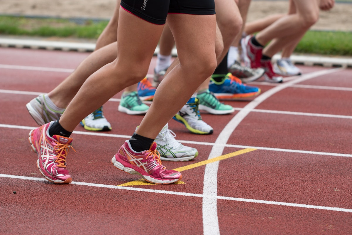 athletes about to start running on a running track